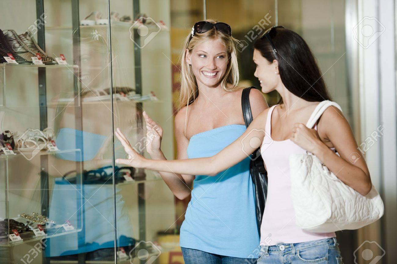 Young women looking through shop window Stock Photo - 7511586