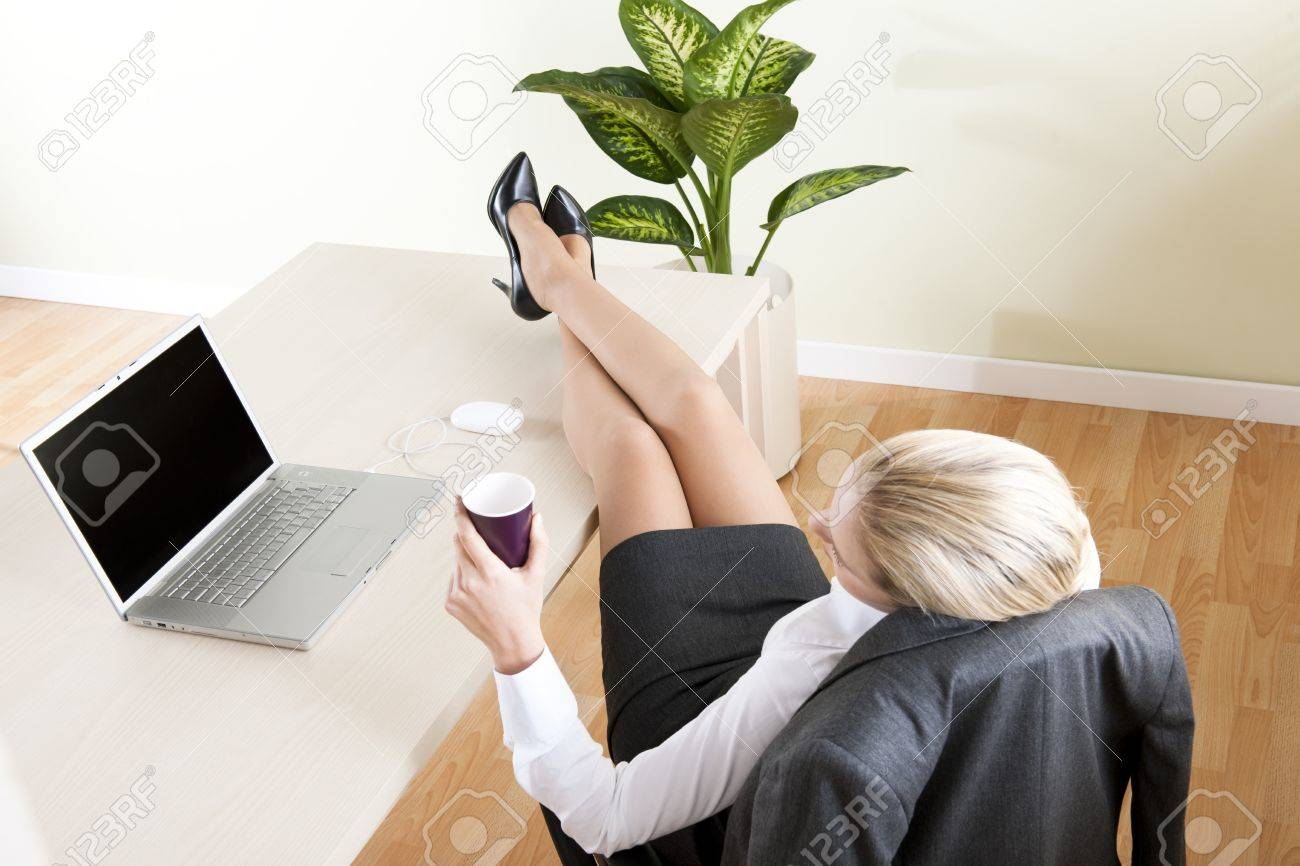 Relaxed businesswoman with legs on the desk Stock Photo - 7815996