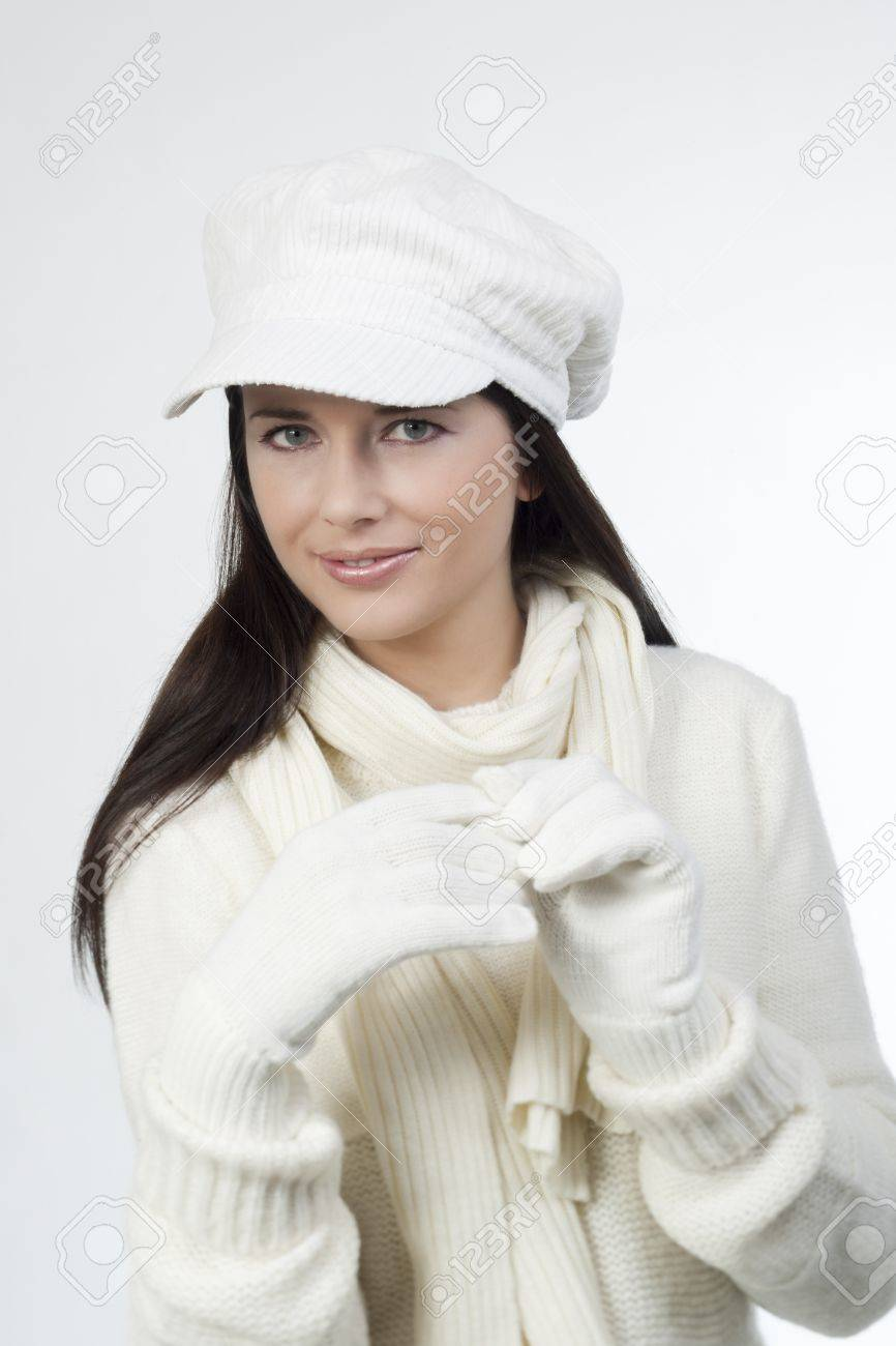 Young Woman In Soft White Sweater And Cap, Wearing Mittens Stock ...