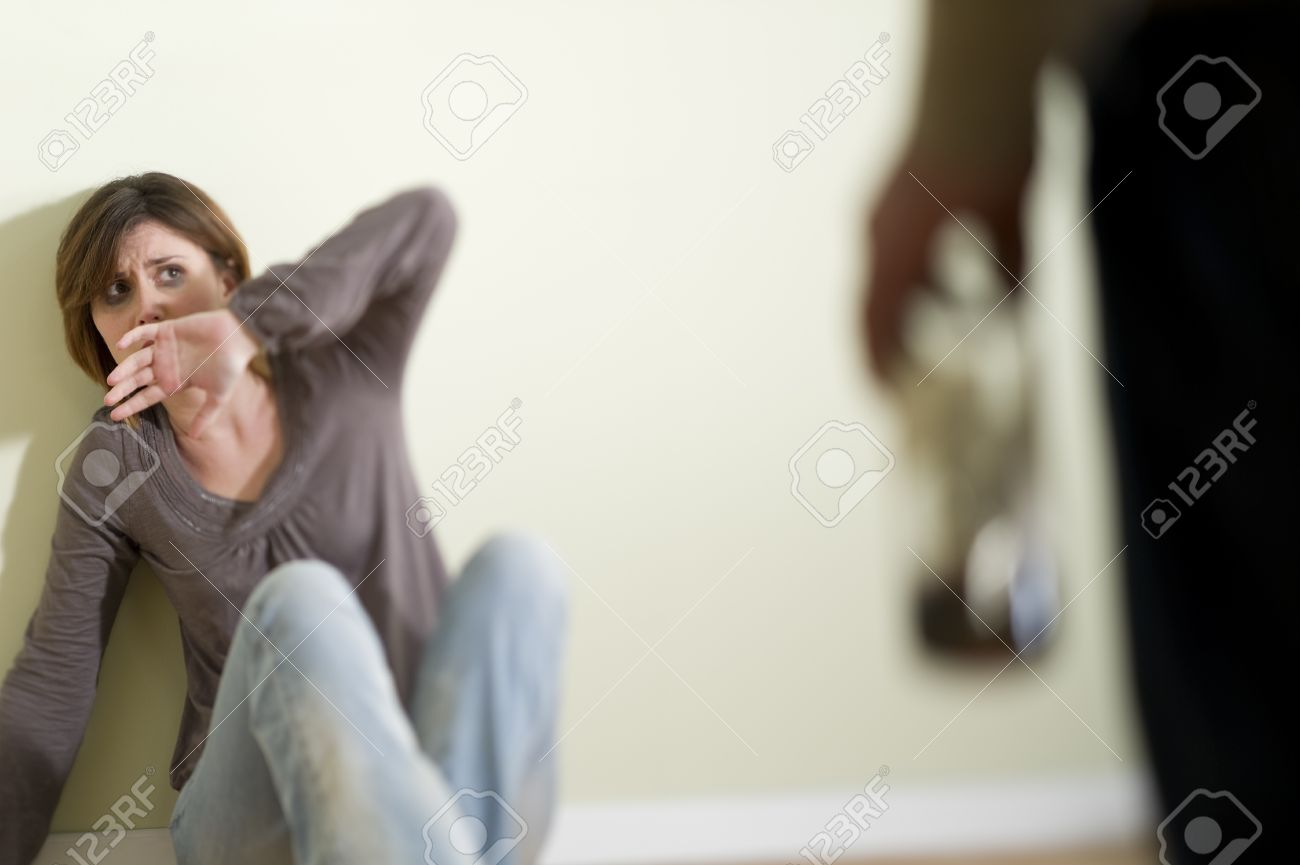 Woman scared of a man holding a bottle; Concept: abuse/domestic violence due to alcoholism Stock Photo - 9051860
