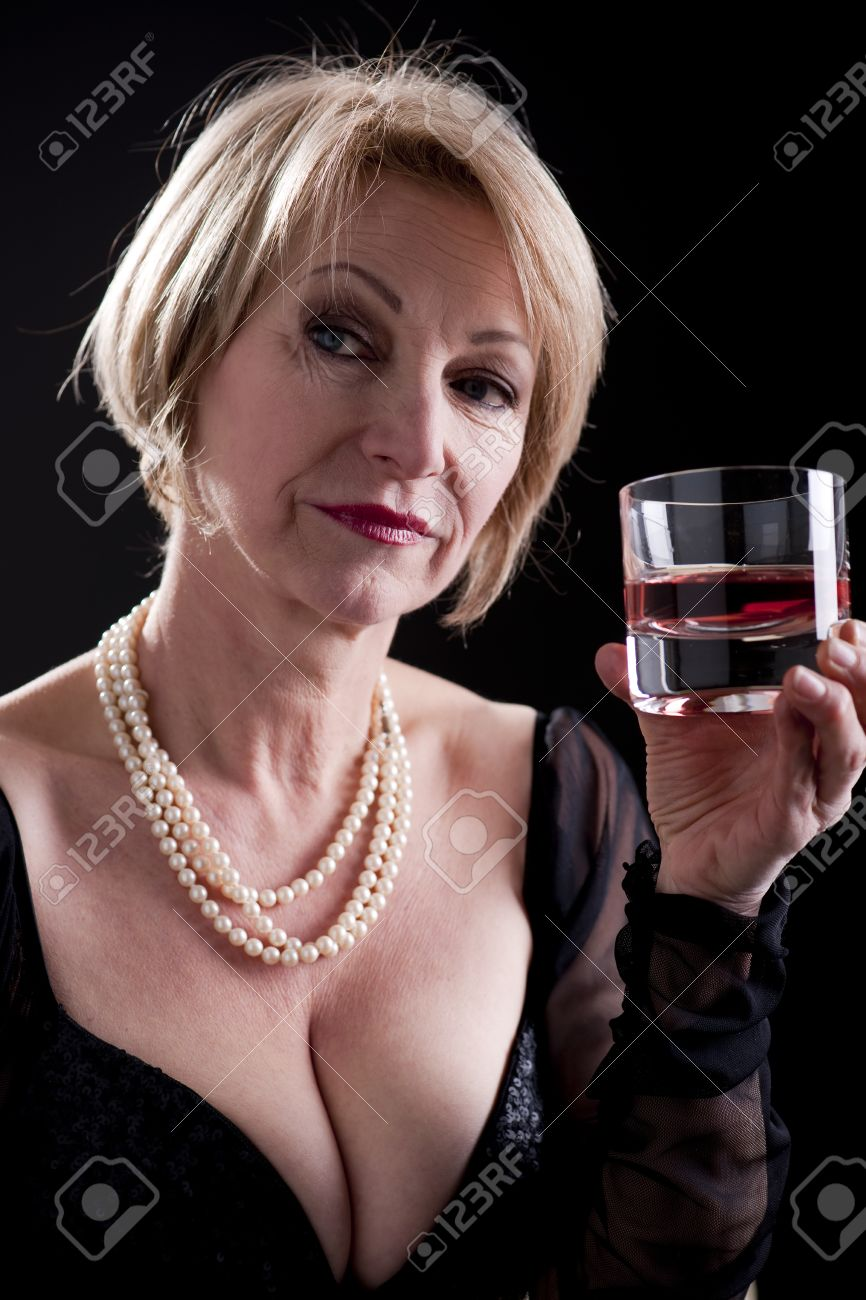 pensive woman with drink, black background stock photo, picture and
