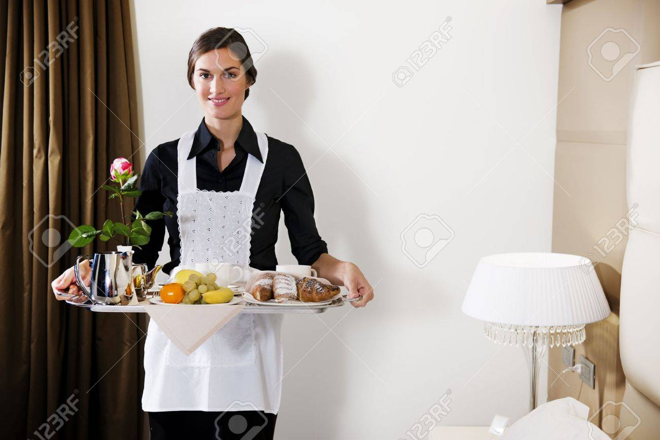 Happy Maid Carrying Breakfast Tray Stock Photo - 9319554