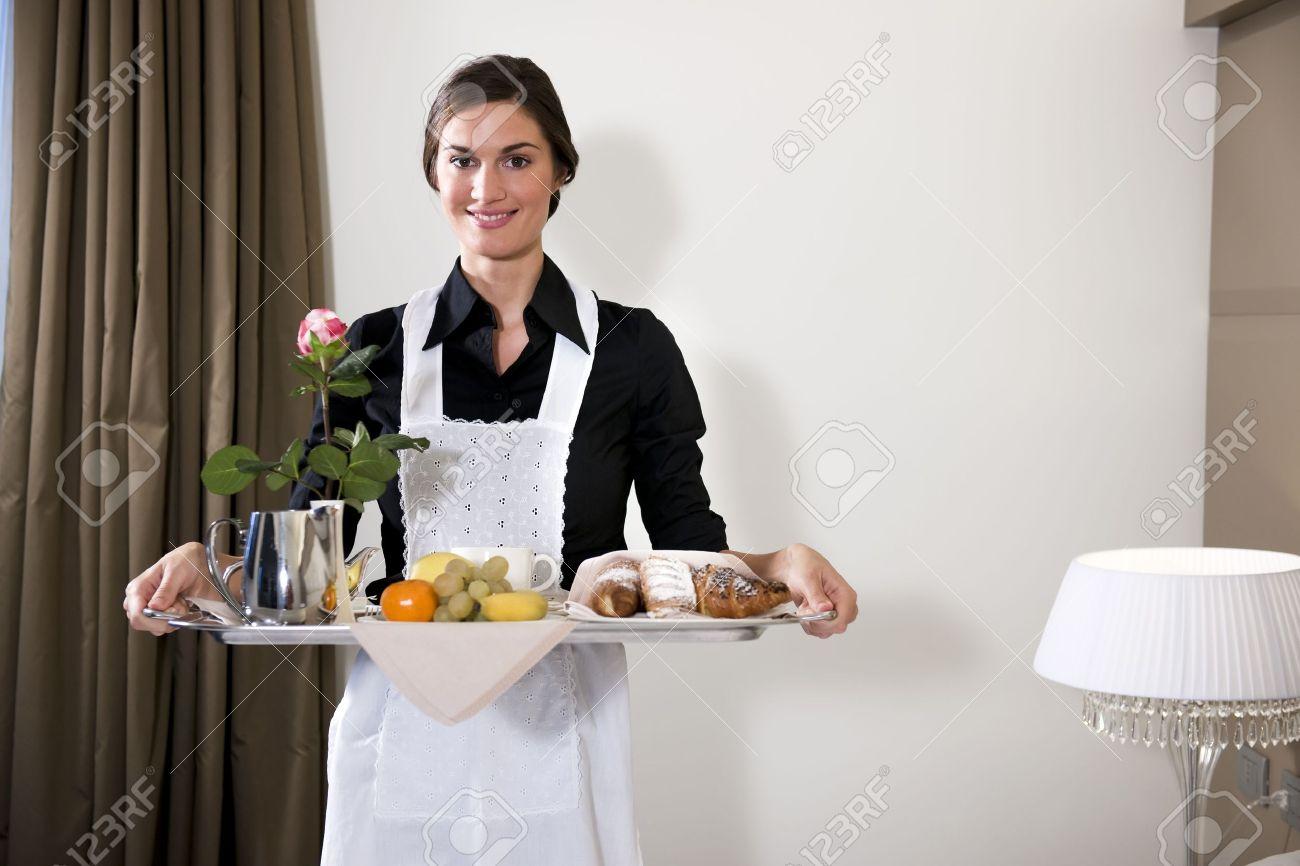 Happy Maid Carrying Breakfast Tray Stock Photo - 9319558