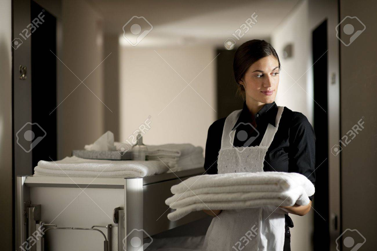 Maid with housekeeping cart Stock Photo - 9319548