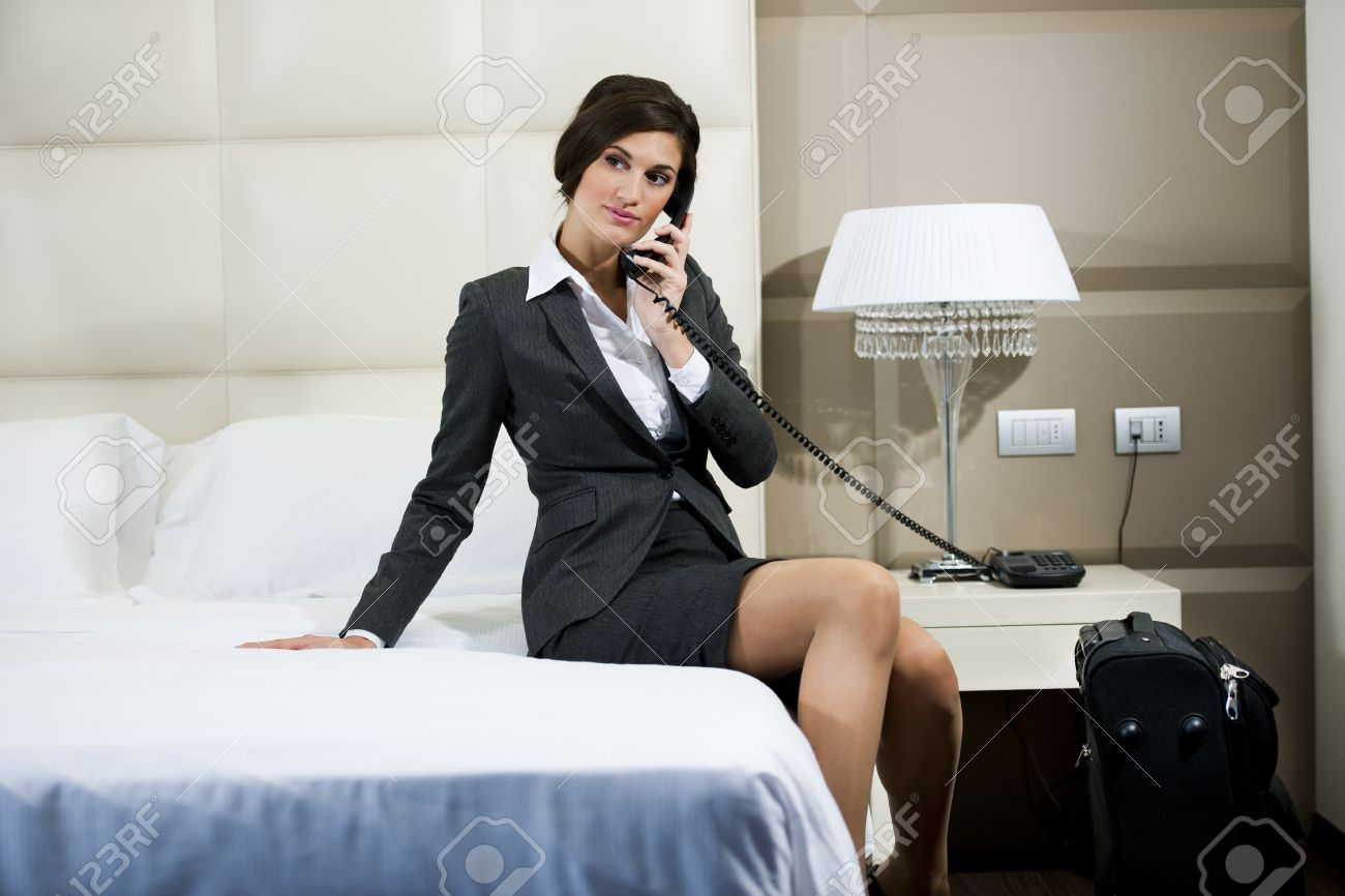 Businesswoman on the phone in hotel room Stock Photo - 9741072