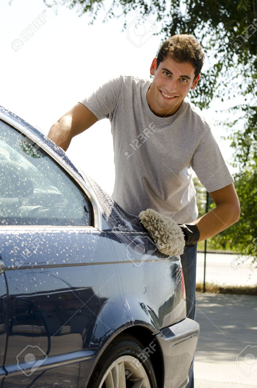 Young man cleaning a car with sponge - 12967837