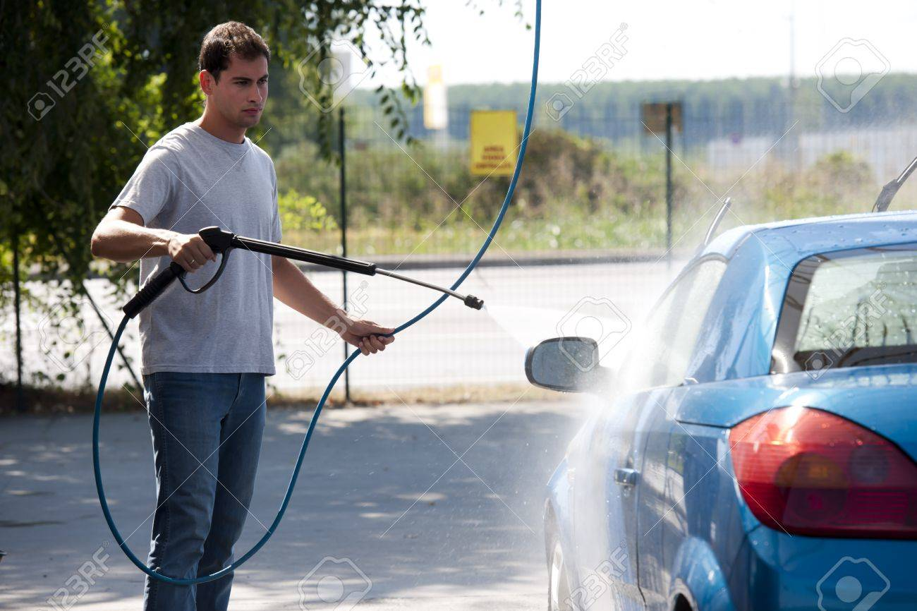 Young man washing his car with compression water - 12967934