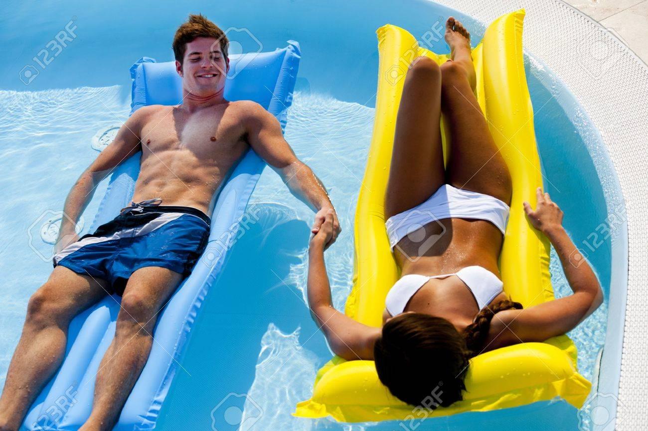 Young couple enjoying floating on pool Stock Photo - 13245446