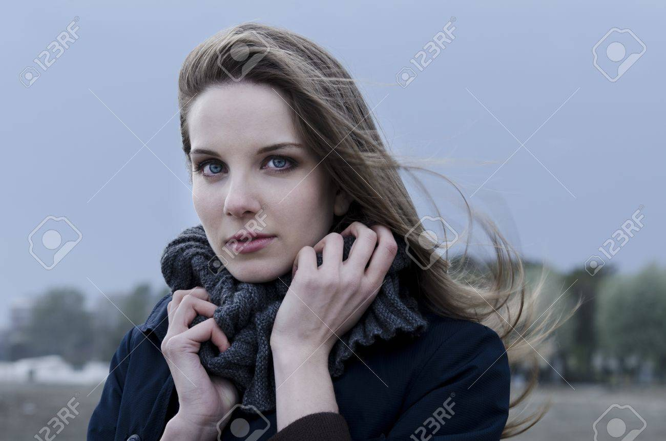 Young woman on the beach during a windy day Stock Photo - 15553618