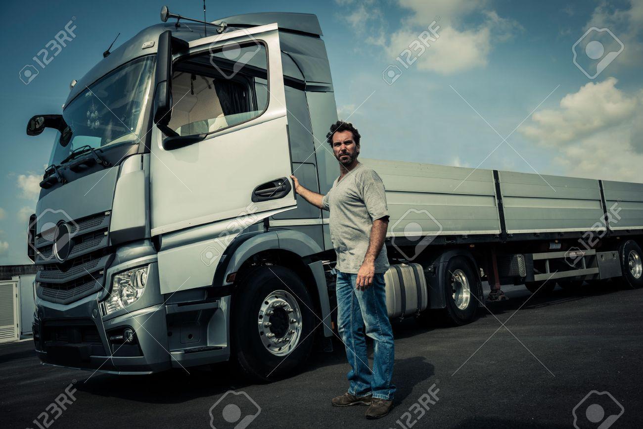 Portrait of a truck driver - 33894234