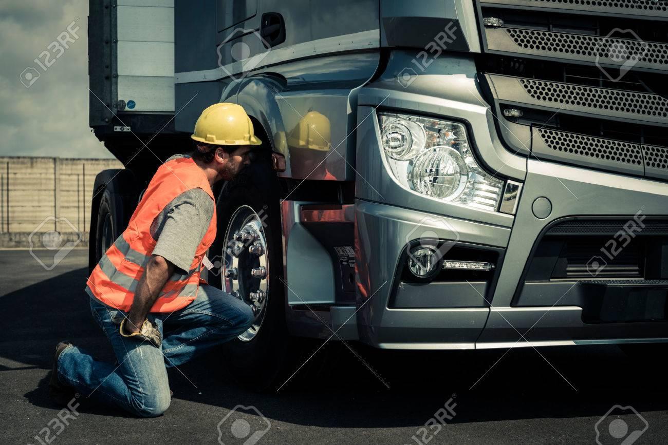 Truck driver preparing his truck - 33894253
