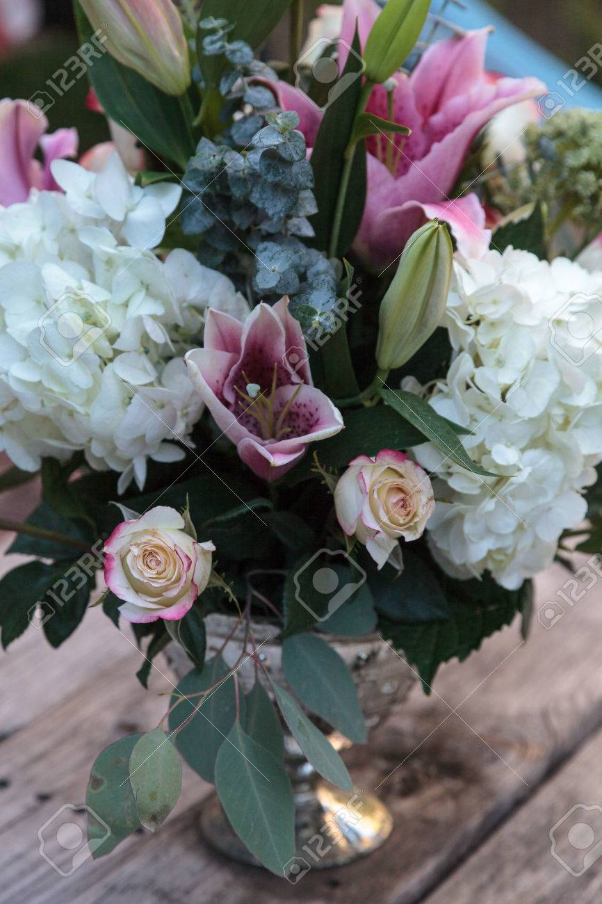 Wedding bouquet of white and pink flowers including roses hydrangea stock photo wedding bouquet of white and pink flowers including roses hydrangea star gazer lilies and queen annes lace on a rustic table in the french izmirmasajfo