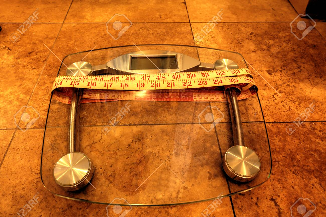 scale to monitor weight with a measuring tape to take measurements