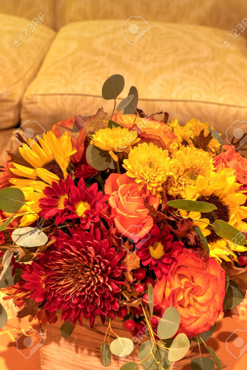 Fall Colored Flower Bouquet That Includes Orange Roses Yellow Stock Photo Picture And Royalty Free Image Image 140436110