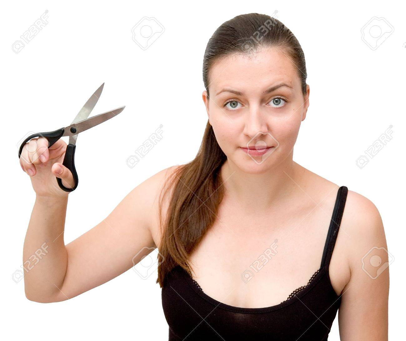 The young woman with scissors on a white background Stock Photo - 1158742