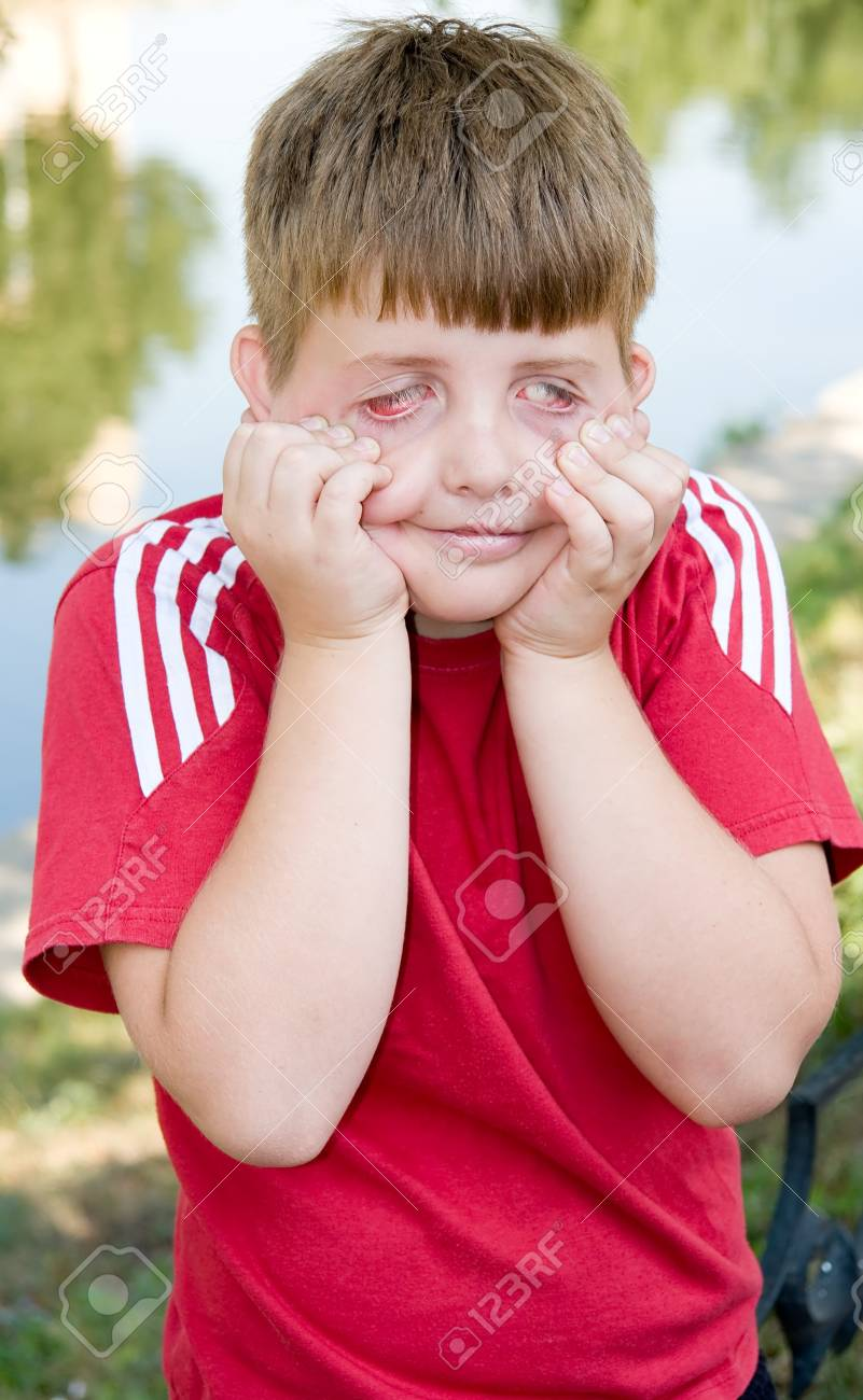 I can make this face...  Young boy pulling a scary face Stock Photo - 1592642