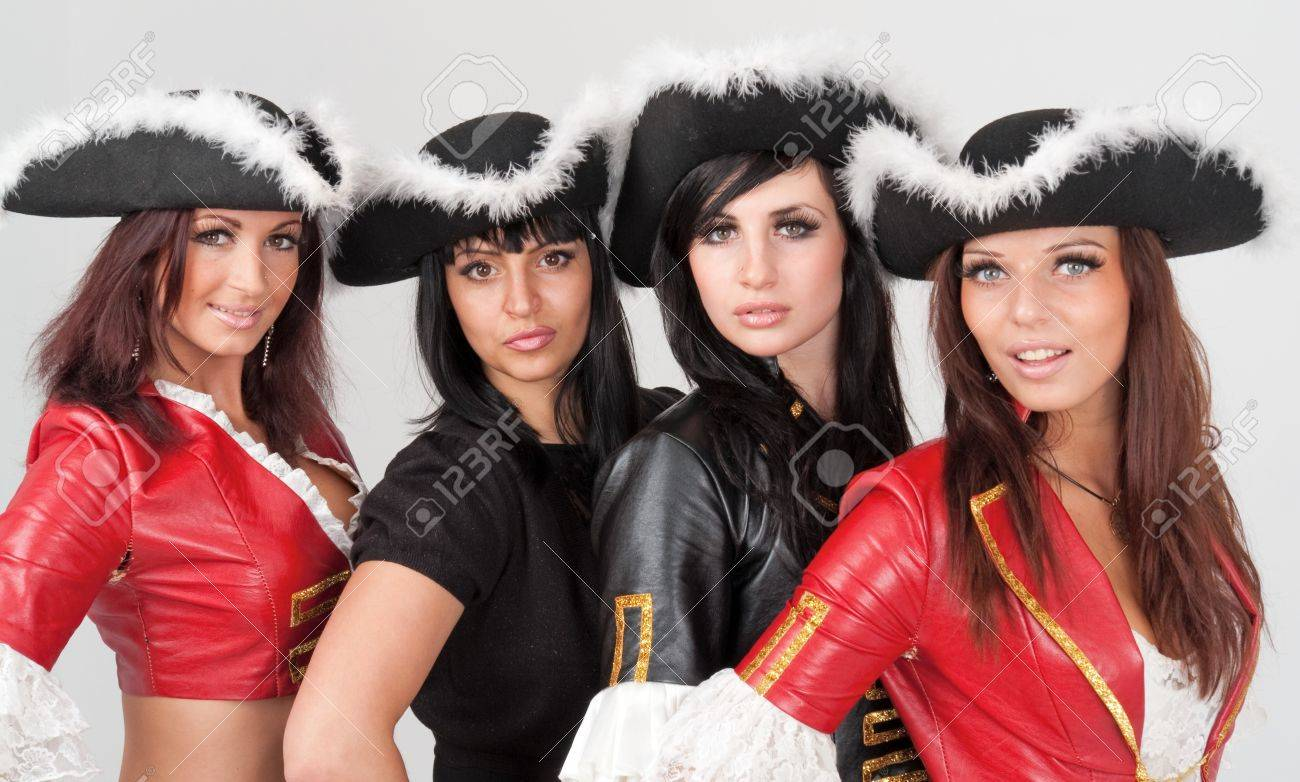 young women in pirate costumes on a gray background Stock Photo - 4542971