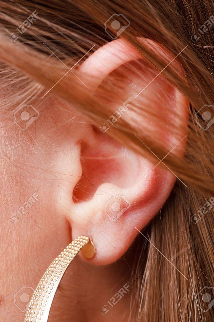 beautiful female ear with earring close up Stock Photo - 4630656