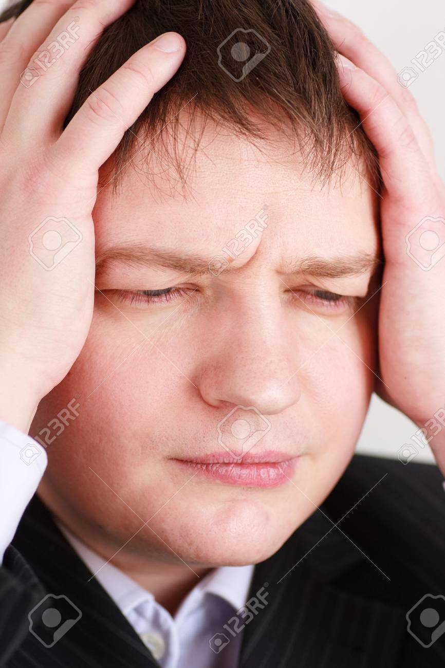 Crisis. Stressed young business man close up. Stock Photo - 4853004