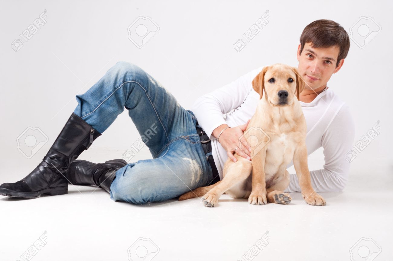 Attractive Young Man With Dog