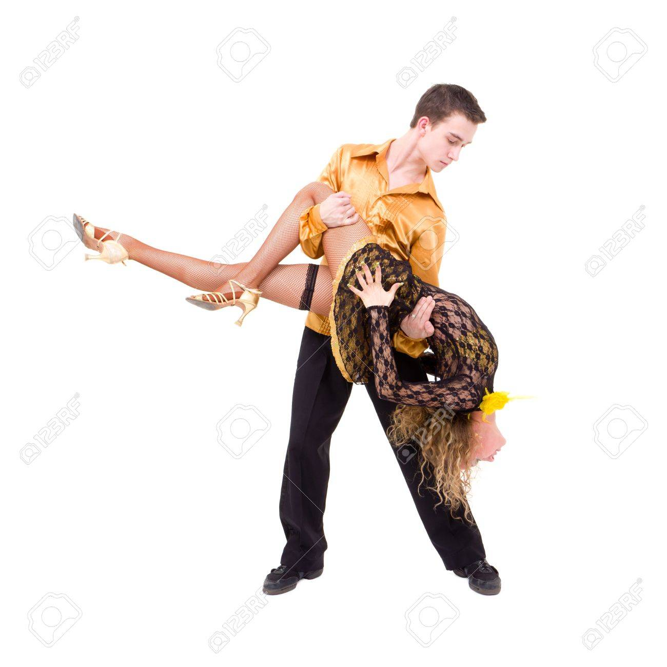 Young couple dancing latino against isolated white background Stock Photo - 8334706