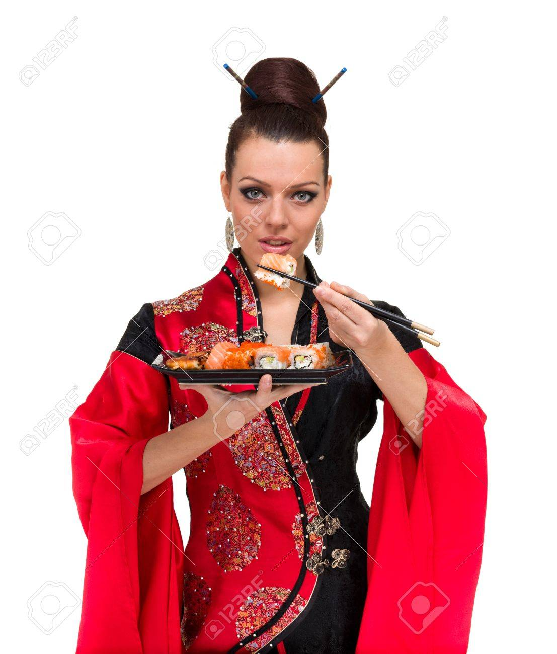 Attractive woman in traditional dress with sushi, isolated on white background Stock Photo - 15531571