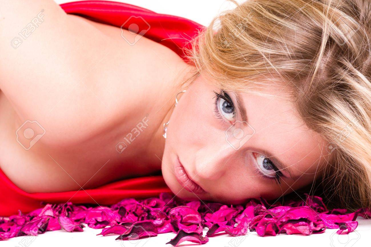 shot of sexy woman in red dress with rose petals, isolated on white background Stock Photo - 18626462