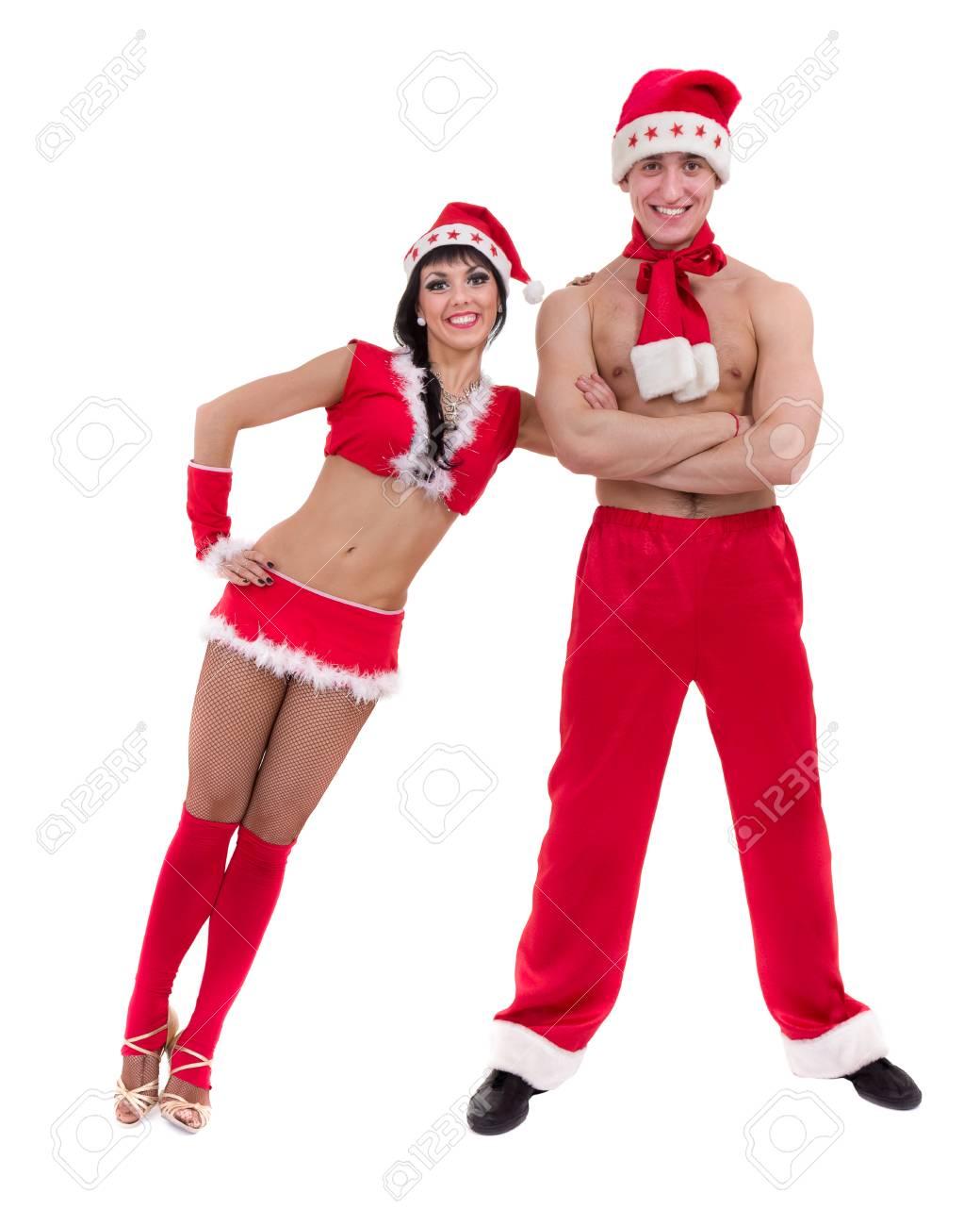 Bonne Jeune Couple Portant Le Père Noël Vêtements Posant Sur Fond Blanc Isolé Banque D Images Et Photos Libres De Droits Image 59035100