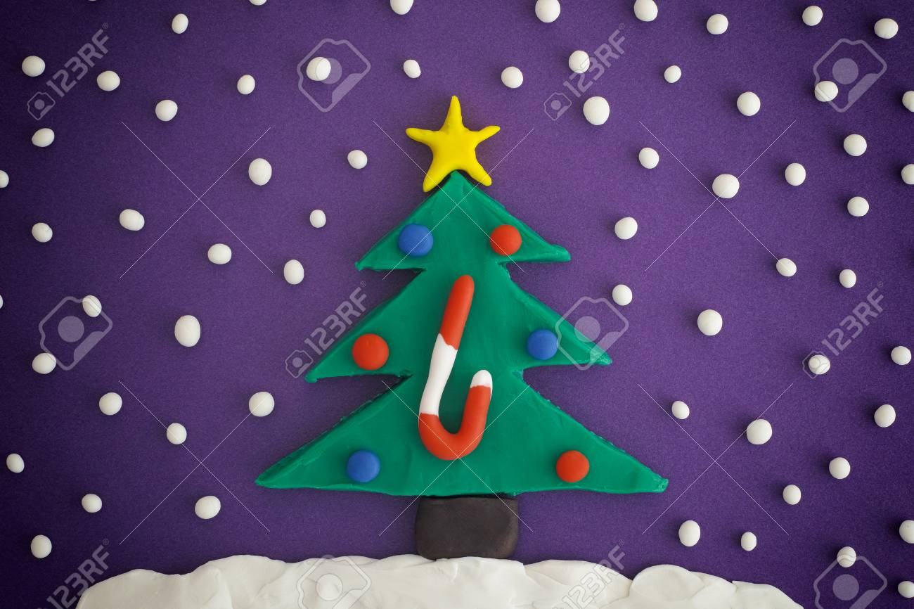 christmas tree with ornaments and candy cane christmas tree ornaments and snow are made