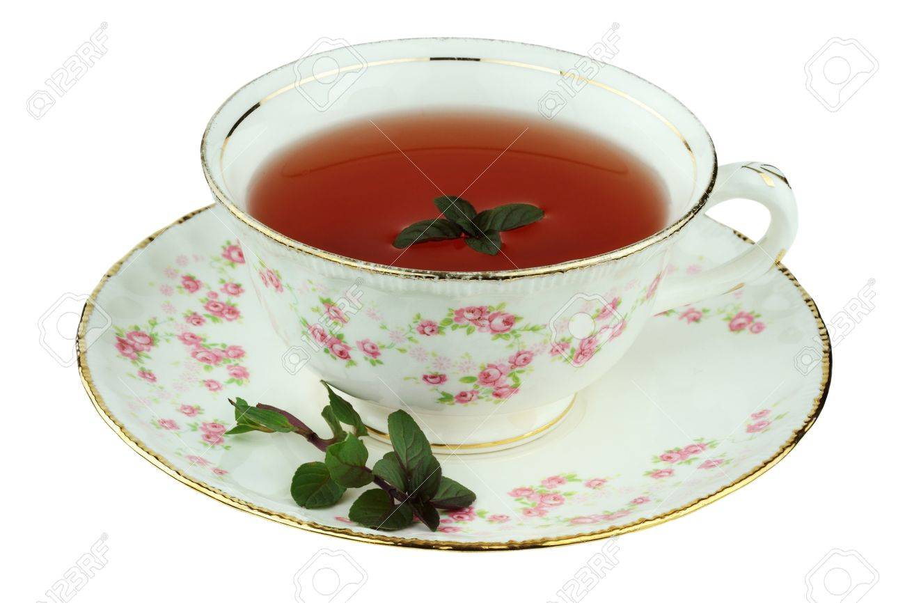 Chocolate peppermint tea in an antique tea cup isolated on a white background with clipping path. Stock Photo - 9553101