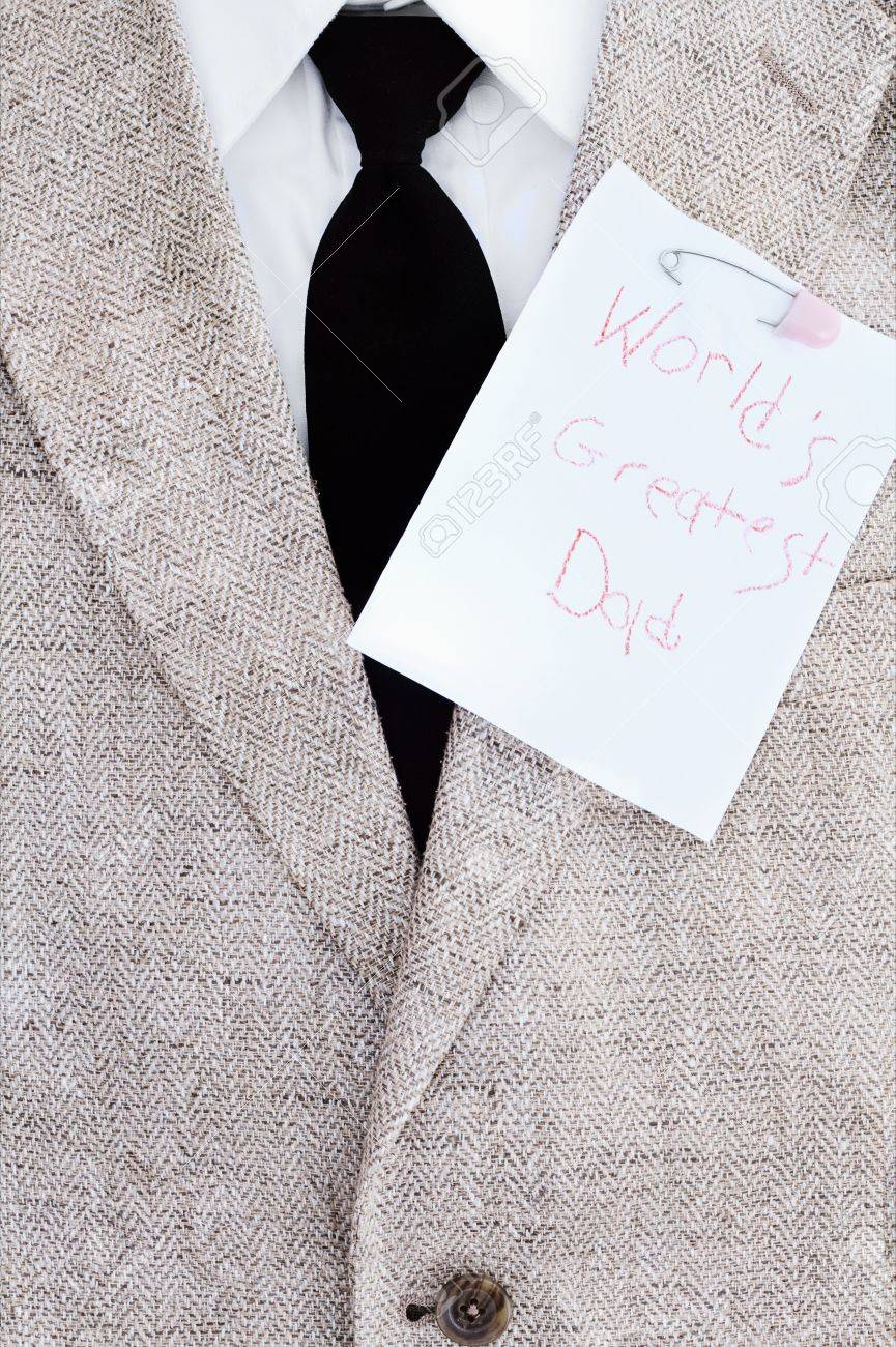 Man's suit jacket, tie and shirt with World's Greatest Dad note pinned over his heart. Stock Photo - 13966141
