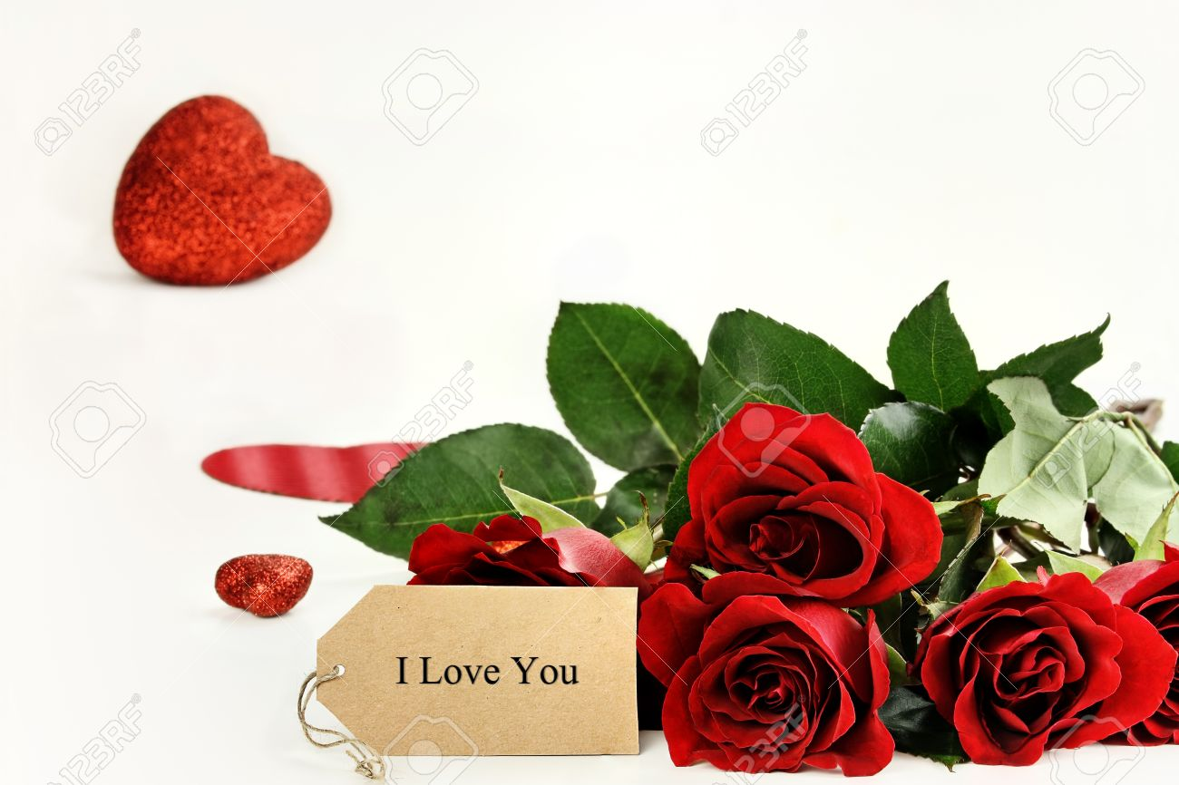 Red Roses With An I Love You Card And Glitter Hearts In The Background Stock Photo Picture And Royalty Free Image Image 64001099