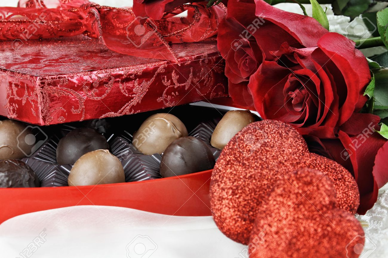 Heart Shaped Box Of Valentines Day Chocolates With Beautiful Stock