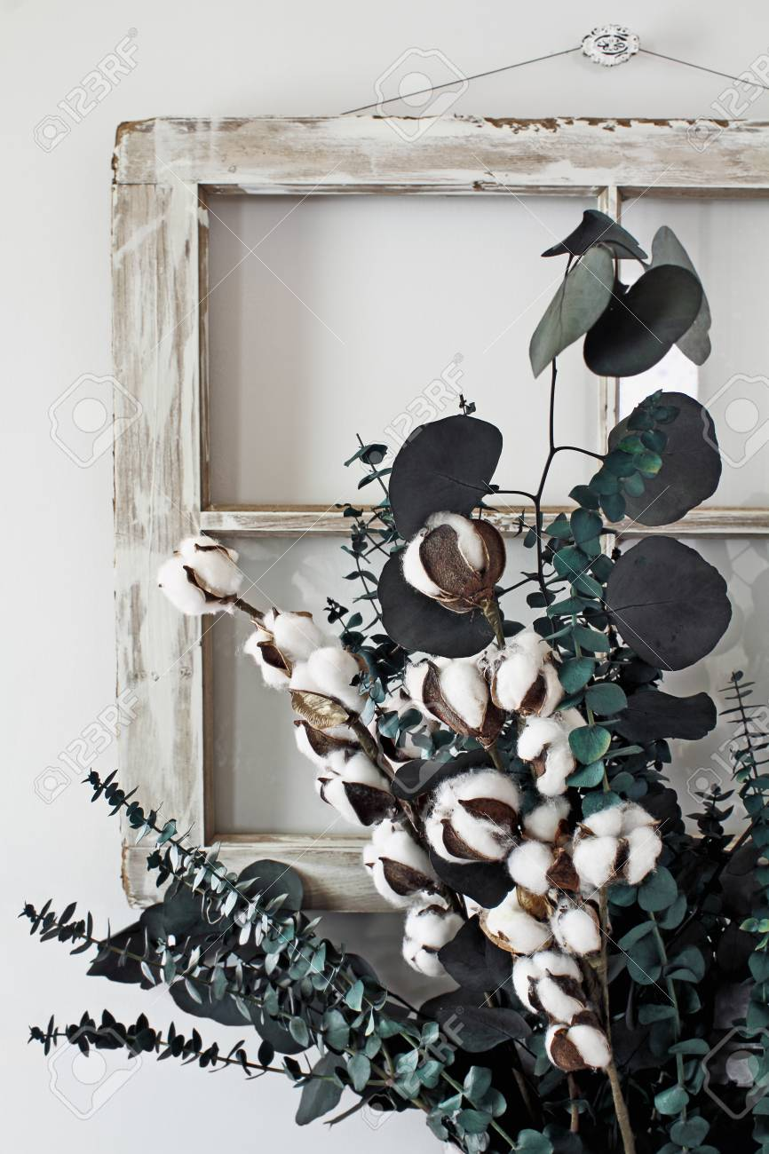 Eucalyptus And Cotton Stem Arrangement In Front Of An Old Farmhouse Stock Photo Picture And Royalty Free Image Image 109236855