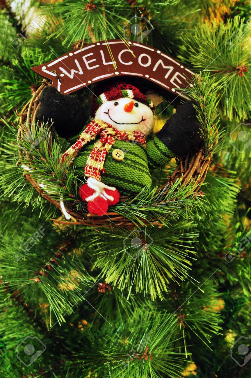 Snowman Wreath Hanging On Christmas Tree With Welcome Message ...