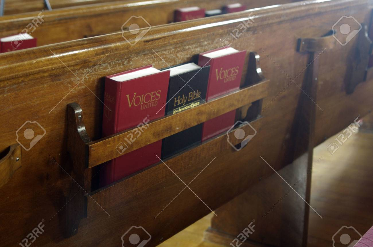 a bible and song books in a church pew stock photo - Church Pew