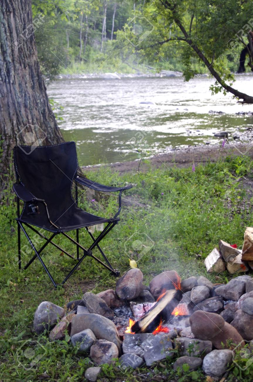 Camping Chair At Campfire Near River