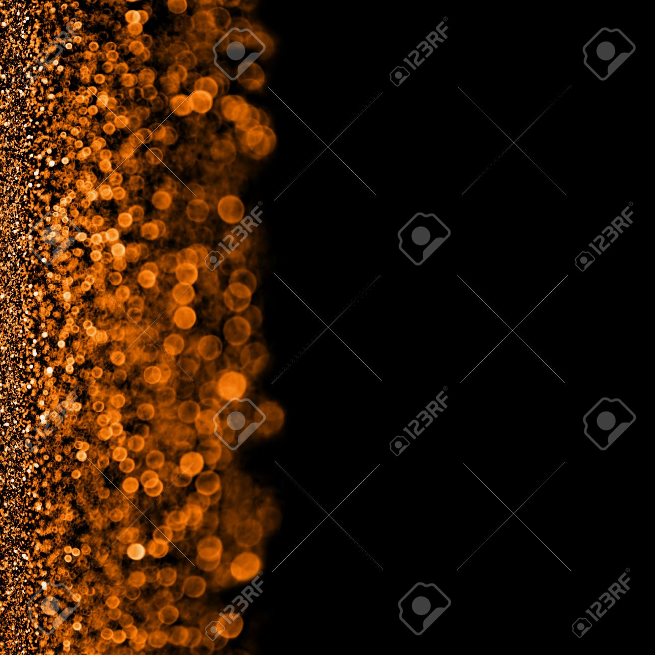 Abstract Orange Sparkle Confetti On Black Background With Copy