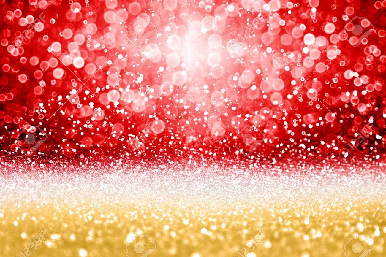 elegant red and gold glitter sparkle confetti background for stock
