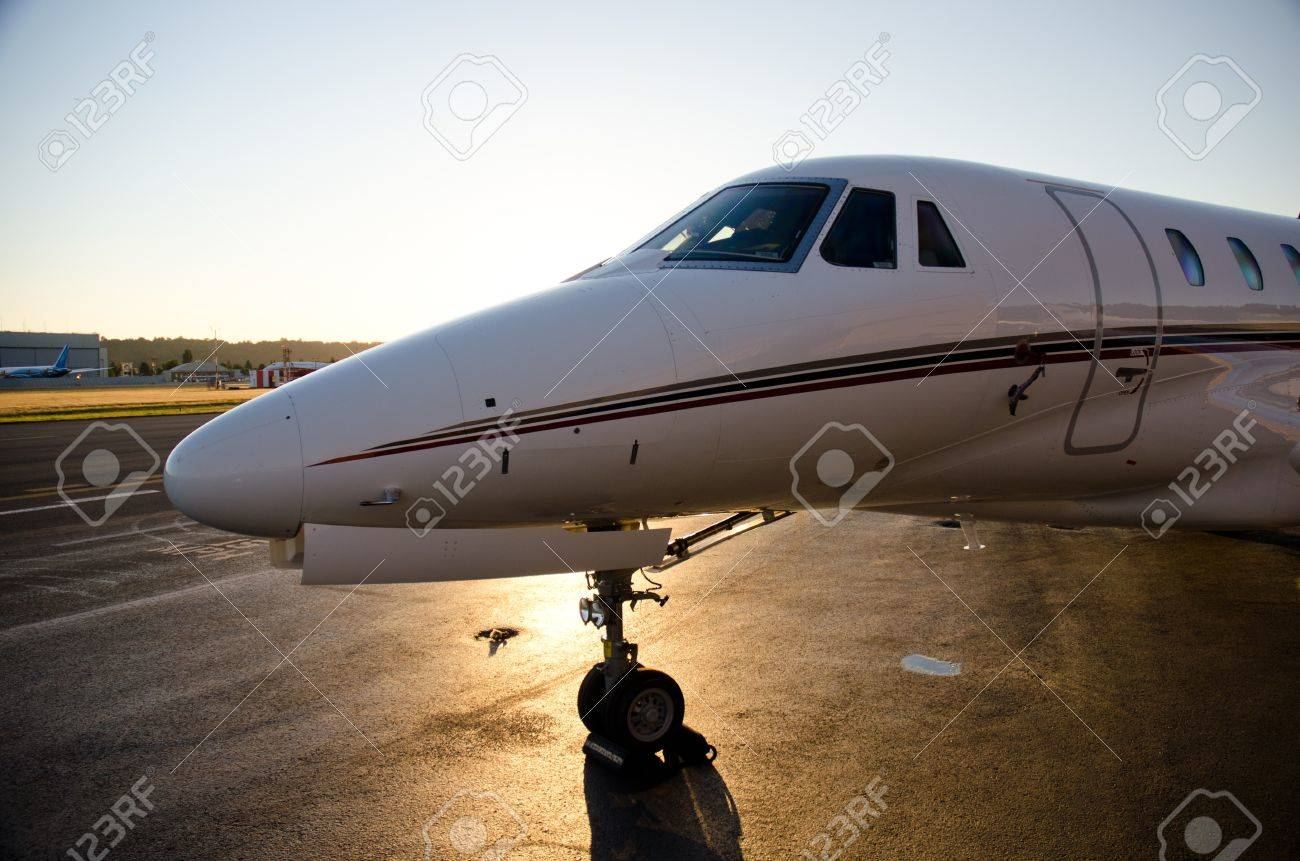 Citation X sits on the ramp at sunset. Stock Photo - 11078832
