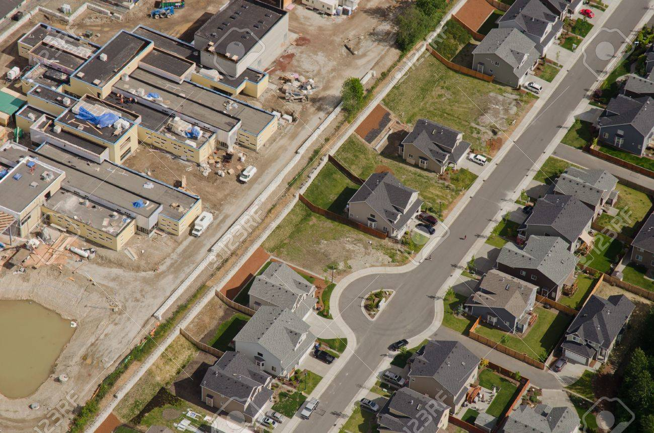 Aerial view of new retail development behind quiet suburban homes Stock Photo - 11268308