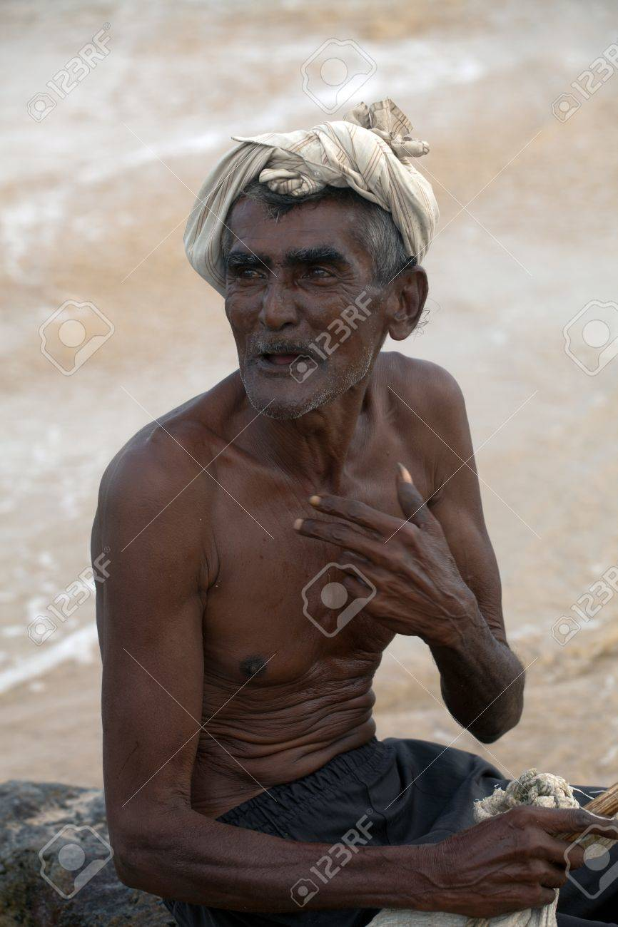 Portrait: the old man from sri lanka sits on the shore of the ocean - 10317560