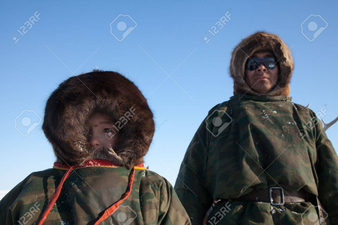 Nenets family - father and son - the reindeer herders. The Far North, Russia - 13744368