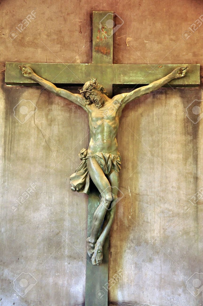 a statue of jesus christ crucified on a cross stock photo
