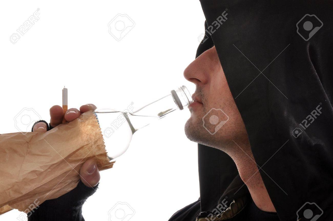 homeless man holding a bottle of vodka, heavy drinking problem. Stock Photo - 6495711