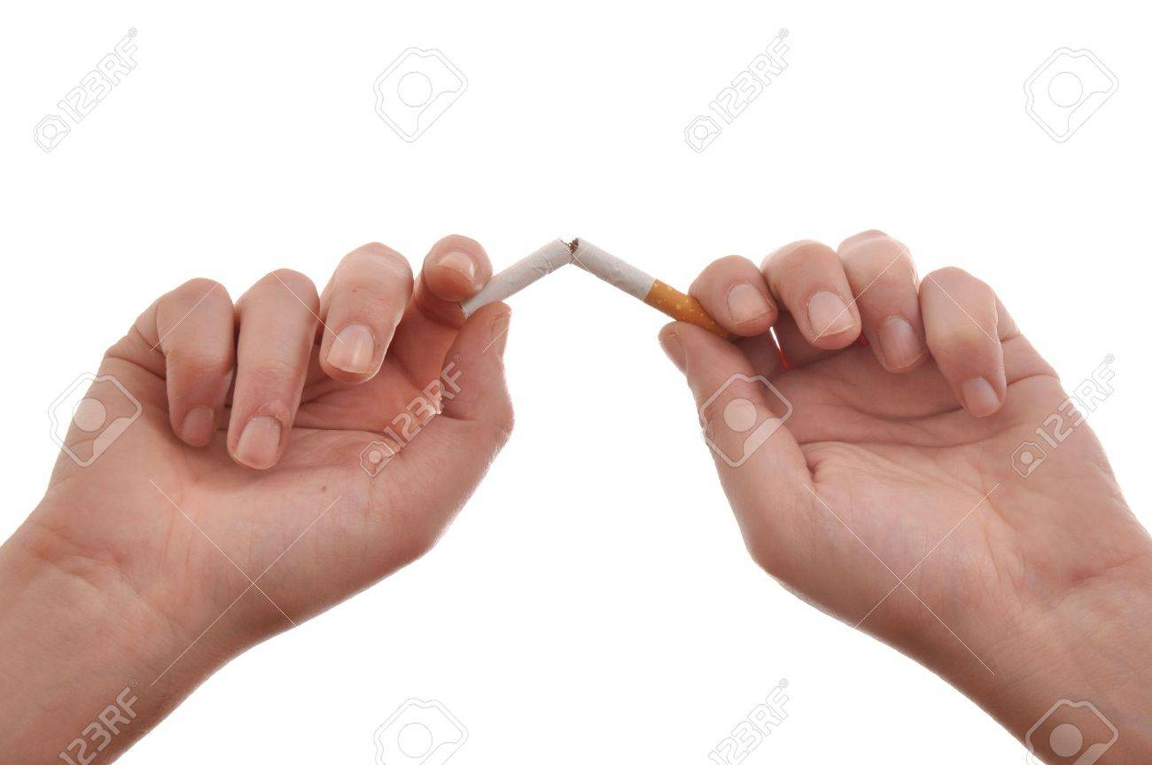 Quit smoking, hands are breaking a cigarette. Stock Photo - 6495743