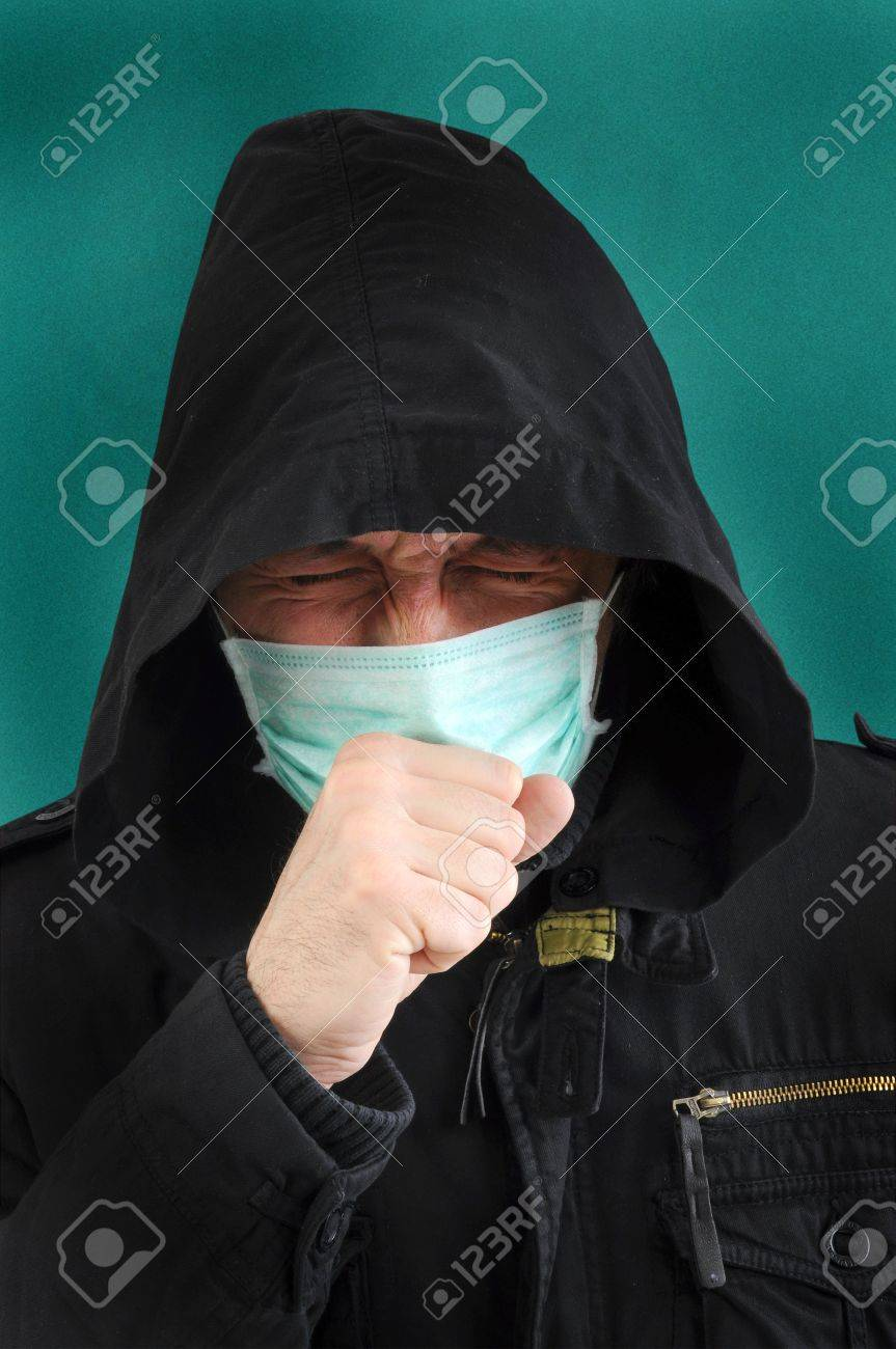 A man with a medical mask covering face, coughing. Stock Photo - 6524976