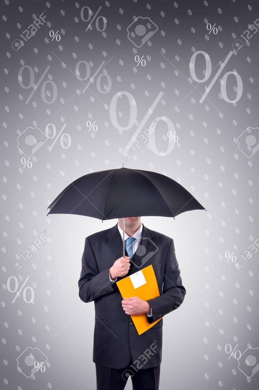 Businessman is holding an umbrella, illustrated rain made of percentage symbols Stock Photo - 6752654