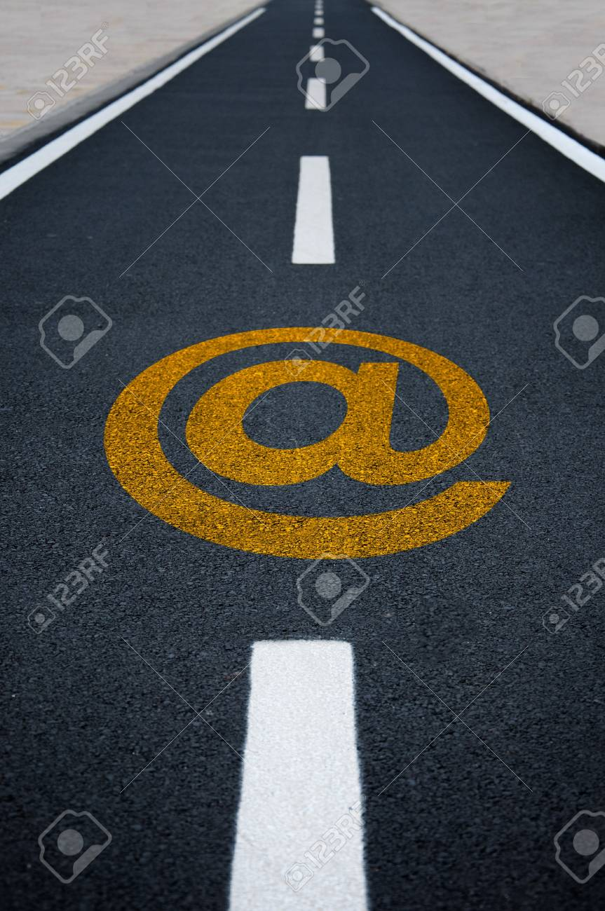 A straight tamac bicycle road with @ sign Stock Photo - 9919204