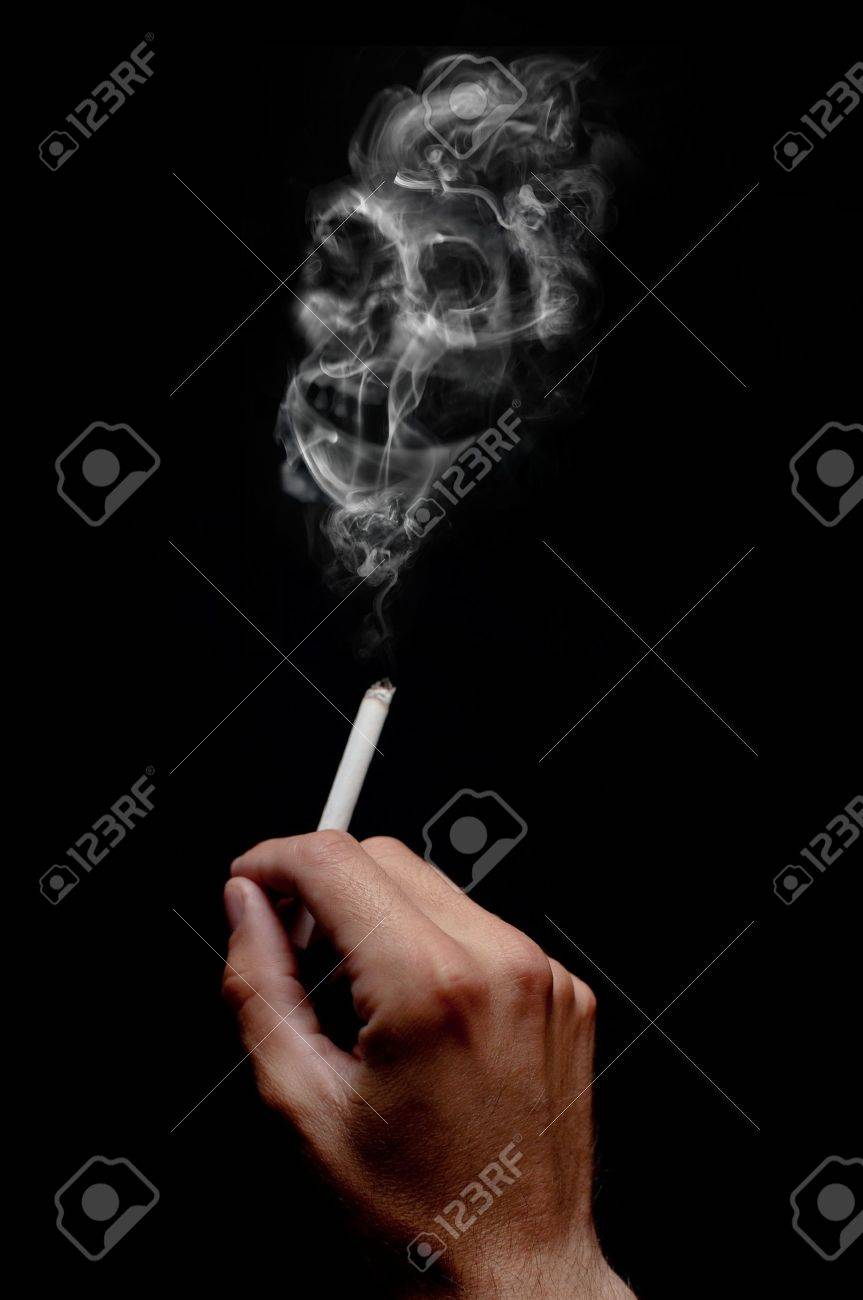 A smoking cigarette over a dark background, low key light. Stock Photo - 9918847